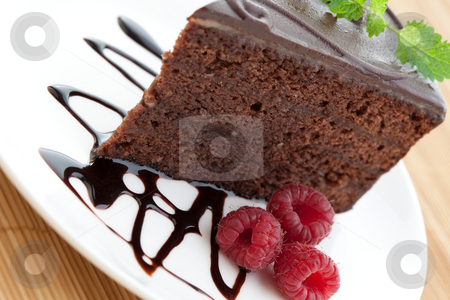 Slice of delicious chocolate cake with fresh raspberries stock photo, Slice of delicious chocolate cake with raspberries and mint by Robert Anthony