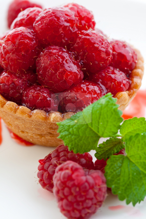 Delicious fresh raspberry tart stock photo, Delicious raspberry tart with home grown raspberries and a mint leaf by Robert Anthony