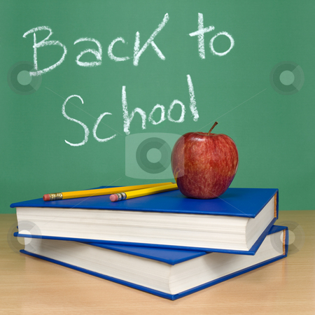 Back to school stock photo, Back to school written on a chalkboard. Books, pencils and an apple on foreground. by Ignacio Gonzalez Prado