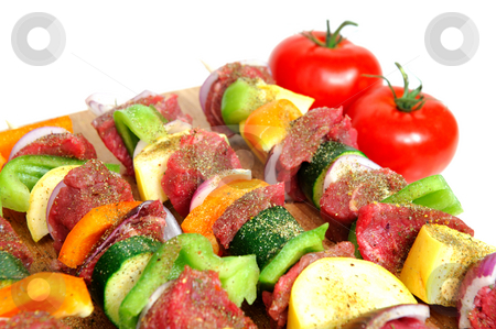 Steak Kabob stock photo, Steak and assoretd vegetables including onion, orange and green bell peppers and summer squash on bamboo skewer sprinkled spices ready for the grill by Lynn Bendickson