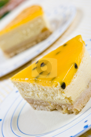 Two slices of homemade orange cheesecake stock photo, Two slices of homemade orange cheesecake on plates by Robert Anthony