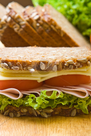 Fresh wholemeal sandwich stock photo, Fresh wholemeal cheese and ham sandwich by Robert Anthony