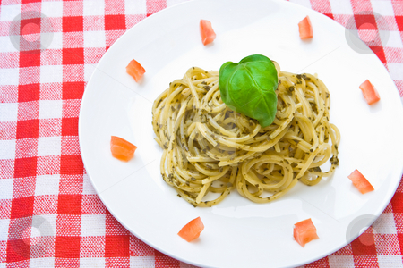 Plate of fresh spaghetti stock photo, Plate of fresh spaghetti with pesto by Robert Anthony