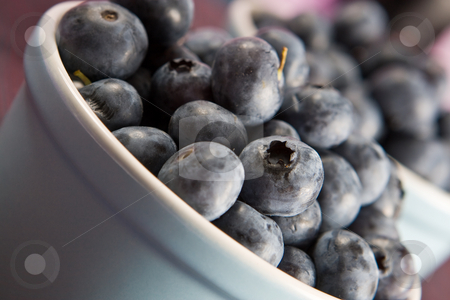 Close up of fresh blueberries stock photo, Close up of fresh blueberries in a dish by Robert Anthony