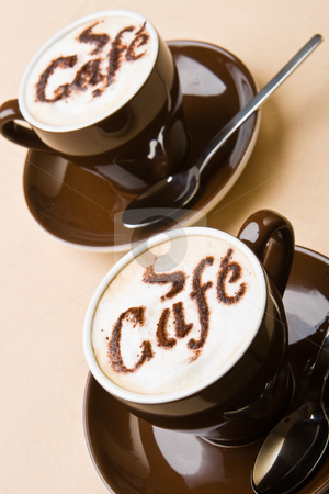 Two cups of fresh cappuccino stock photo, Two cups of fresh cappuccino on a table by Robert Anthony