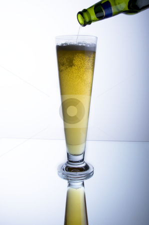 Beer stock photo, Pouring a glass of beer with reflection by Jandrie Lombard