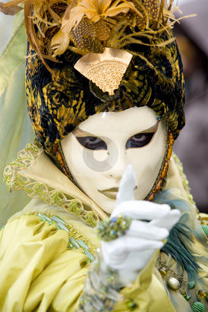 Follow my finger stock photo, A venetian women in a yellow costume with strong eye contact by Robert Anthony