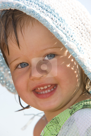 Smile stock photo, Portarit of little nice girl on the hat by Gennady Kravetsky
