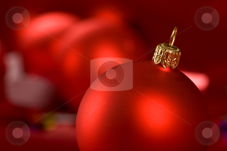 Red christmas ball stock photo, Holiday series: some red christms ball over red background by Gennady Kravetsky