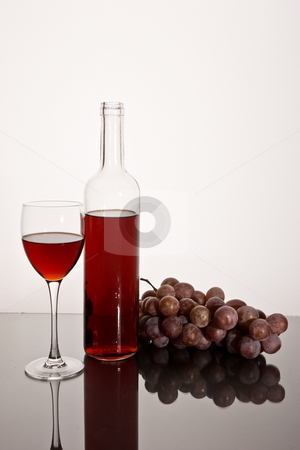 Red wine stock photo, Drink series: red wine glass and bottle with grapes by Gennady Kravetsky
