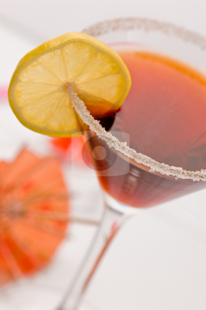 Cocktail with lemon stock photo, Drink series: red cockatil with shugar and lemon by Gennady Kravetsky
