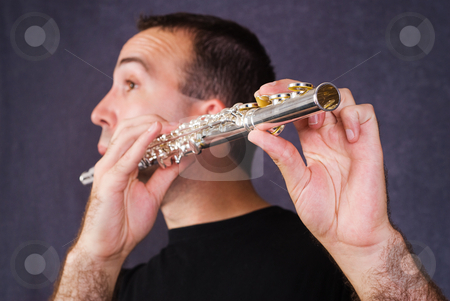 Wind Instrument stock photo, Closeup view of a young male playing his wind instrument by Richard Nelson