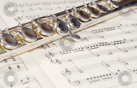 Wind Instrument stock photo, Closeup view of a metal wind instrument shot on a music sheet by Richard Nelson