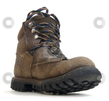 Heavy worn out hiking boot stock photo, Heavy worn out hiking boot with colorful laces on white background, low angle distorted perspective by Marek Uliasz