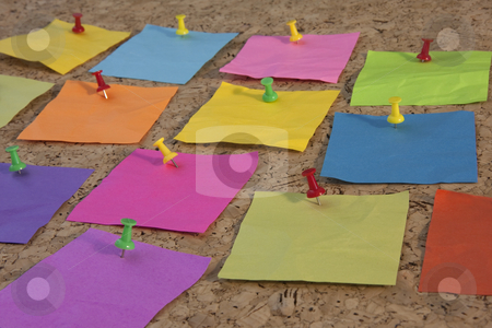 Colorful blank sticky notes on cork board stock photo, Colorful blank notes pinned on cork bulletin board, low angle perspective by Marek Uliasz