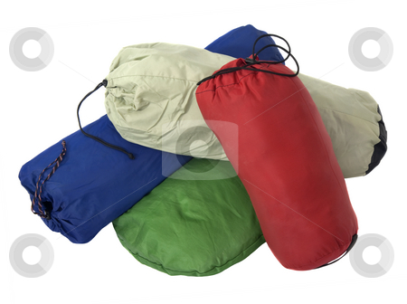 Colorful bags with camping equipment stock photo, A pile of colorful bags with camping equipment (tent, sleeping bag, pad) isolated on white by Marek Uliasz