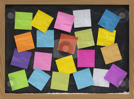 Colorful blank notes on blackboard stock photo, Blackboard covered with colorful blank sticky notes by Marek Uliasz