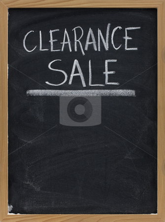 Clearance sale blackboard sign stock photo, Clearance sale text handwritten with white chalk on blackboard with copy space below by Marek Uliasz