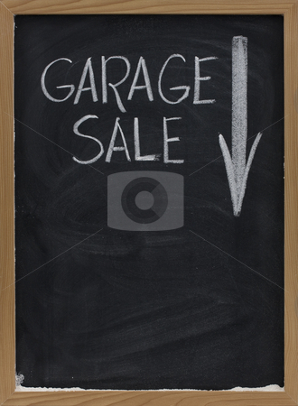 Garage sale blackboard sign stock photo, Garage sale text handwritten with white chalk on vertical blackboard with arrow and copy space below by Marek Uliasz