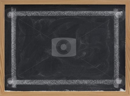 Blank blackboard with eraser smudges stock photo, Blank blackboard with eraser smudges and thick white chalk line frame by Marek Uliasz