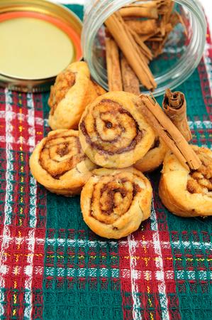 Cinnamon And Rolls stock photo, Stick cinnamon with freah baked mini cinnamon rolls by Lynn Bendickson