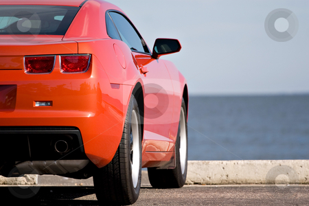 Modern Sports Car stock photo, A modern sports car parked at the beach. by Todd Arena