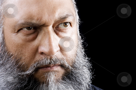 Menacing Man stock photo, Stock image of menacing man with long beard over dark background by iodrakon