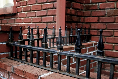 Brick And Iron stock photo, Iron railing abstract with brick background by Jack Schiffer