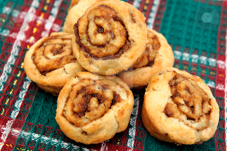 Small Cinnamon Rolls stock photo, Little cinnamon pastries on red, green and white fabric by Lynn Bendickson