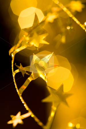 Golden garland stock photo, Holiday series: close up of star shaped  christmas garland by Gennady Kravetsky