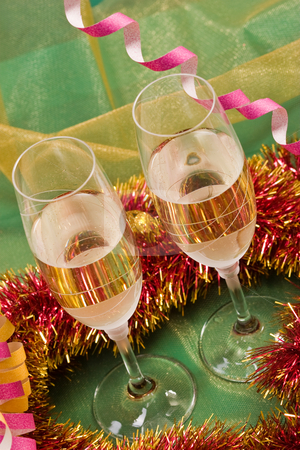 Christmas decoration stock photo, Holiday series: Christmas still life with streamer, garland and champagne by Gennady Kravetsky