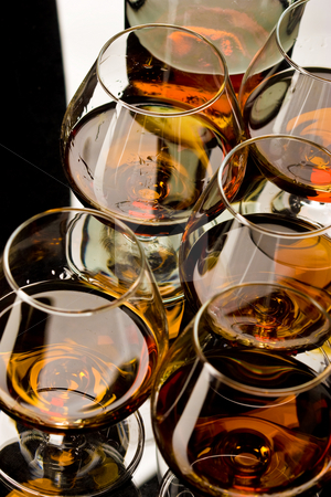 Glasses of cognac  stock photo, Drink series: glass of strong cognac over white by Gennady Kravetsky