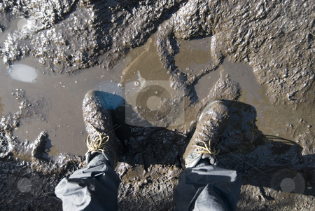 Muddy boots stock photo, Looking down at a pair of muddy walking boots, lens flare by Stephen Gibson