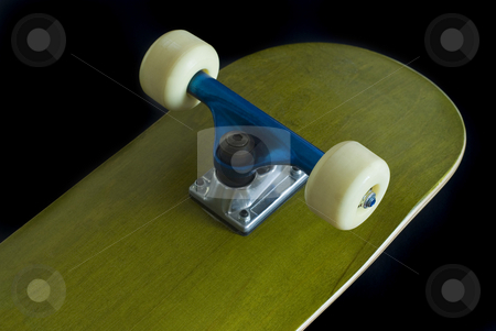 Skateboard stock photo, A green skateboard deck with blue truck on a black background by Stephen Gibson