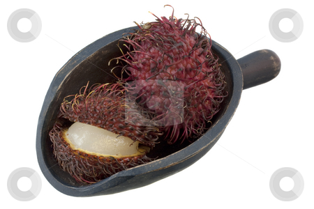 Scoop of rambutan fruits stock photo, Rambutan fruits on a rustic wooden scoop isoalted on white by Marek Uliasz