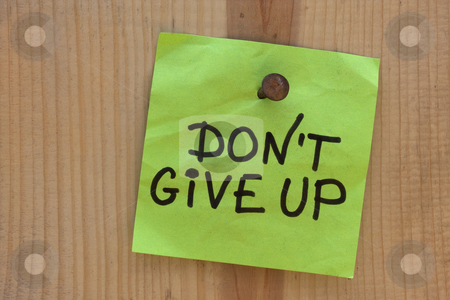 Do not give up - motivational reminder stock photo, Do not give up  - motivational reminder on post note nailed to wooden plank or wall by Marek Uliasz