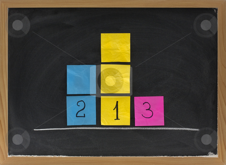 Representation of three level podium on blackboard stock photo, Concept of three level podium to honor medalists in sporting events presented with sticky notes on blackboard by Marek Uliasz