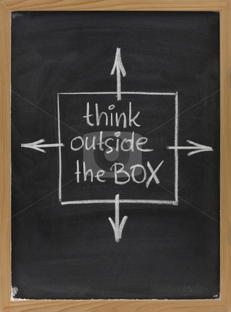 Think outside the box phrase on blackboard stock photo, Think outside the box - concept of different or unconventional thinking sketched with white chalk on a blackboard with eraser smudges by Marek Uliasz