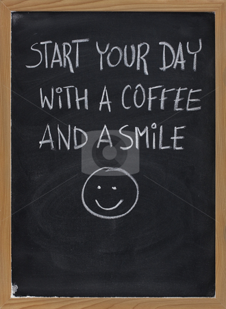 Start your day with coffee and smile stock photo, Start your day with a coffee and a smile - invitation or advertisement handwritten with white chalk on blackboard by Marek Uliasz