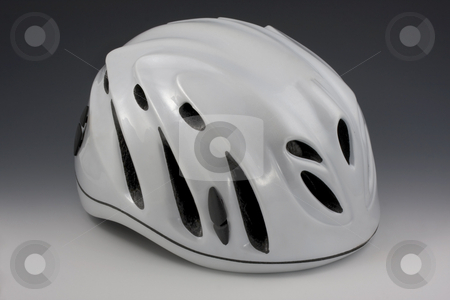 Protective helmet of extreme sports stock photo, White protective helmets with vents for adventure racing and other extreme sports by Marek Uliasz