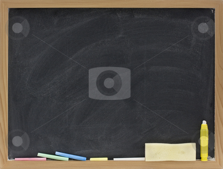 Blank blackboard with eraser smudges stock photo, Small blank blackboard in wooden frame with pieces of chalk and eraser sponge by Marek Uliasz