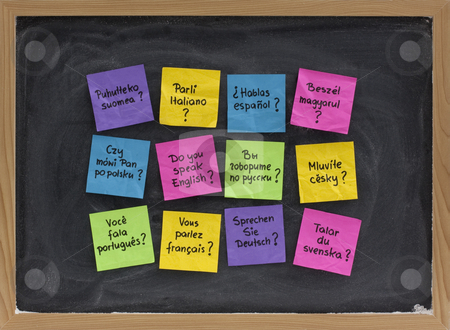 Do you speak question in different languages stock photo, Do you speak question in dozen of languages - colorful sticky notes on blackboard with white chalk smudges by Marek Uliasz