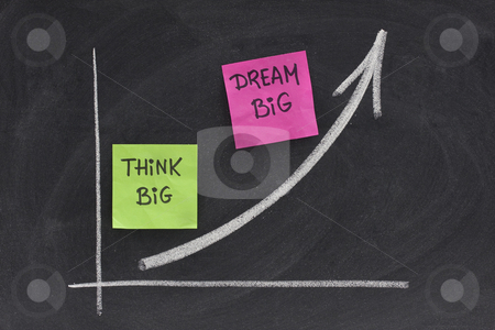 Think big, dream big concept on blackboard stock photo, Think big, dream big slogan concept presented with growing graph on blackboard, eraser smudges by Marek Uliasz