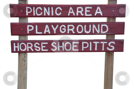 Picnic area and playground sign stock photo, Picnic area, playground and horse shoe pits - weathered wooden red sign isolated with clipping paths by Marek Uliasz