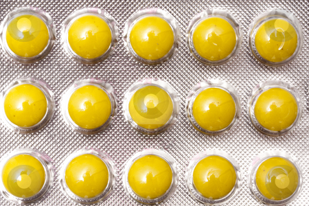 Yellow Pills stock photo, Package of Yellow Pills by Ingvar Bjork