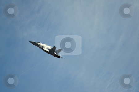 F-18 Hornet stock photo, F-18 Hornet reaching the speed of sound while making an overhead flyby, with the typical white turbulence starting to form around the aircraft at the California Capital Airshow in Sacramento at Mather Field on September 13th 2009 by Lynn Bendickson