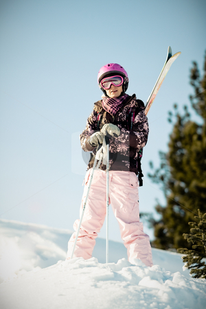 Girl with skis stock photo, Young girl with skis on back by Peter Kirillov
