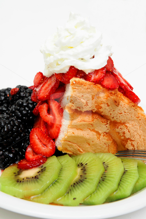 Angel Food Cake And Berries stock photo, Angel Food cake topped fresh sliced strawberries with kiwi fruit and blackberries on the side served on a white plate by Lynn Bendickson