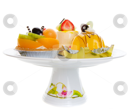 Dessert platter stock photo, Assorted desserts on a pedestal platter over a white background by Steve Mcsweeny