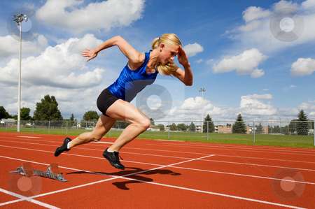 Track athlete stock photo, Track athlete exploding out of the starting blocks by Steve Mcsweeny